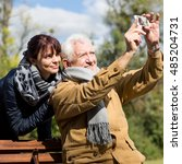 Image Of Elderly Man Taking...
