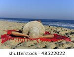summer holiday: woman lying on the beach relaxing and enjoying the sun - stock photo