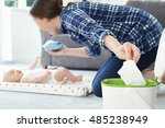 mother disposing of baby wipe... | Shutterstock . vector #485238949