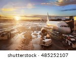 Stock photo airplane being preparing for takeoff at terminal gate in international airport at sunrise 485252107