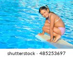 child in swimming pool ... | Shutterstock . vector #485253697