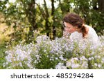 nice girl and flowers in a nice ... | Shutterstock . vector #485294284