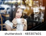 asia girl drinking white cup of ... | Shutterstock . vector #485307601