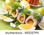 rollmops with gherkins  for easter - stock photo