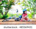girl girl fell off bicycle.... | Shutterstock . vector #485369431