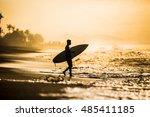 surfers on an ocean beach. | Shutterstock . vector #485411185