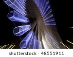 Sky wheel illuminated at night - stock photo