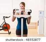 woman weighing herself on...   Shutterstock . vector #48552877