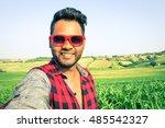 young indian man taking selfie... | Shutterstock . vector #485542327