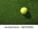 Tennis Ball Against Fake Grass...