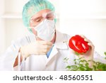 researcher holding up a gmo...   Shutterstock . vector #48560551
