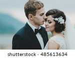 groom kisses stunning bride... | Shutterstock . vector #485613634