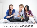three young friends drinking... | Shutterstock . vector #485618959