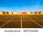 Row Of Colourful Beach Huts At...