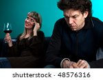 woman talking on the phone and a frustrated man - stock photo