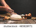 men hands sprinkle a dough with ... | Shutterstock . vector #485828971