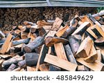 Chopped Firewood Logs In Pile....