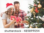 young couple opening a... | Shutterstock . vector #485899054
