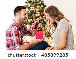 Man Giving A Christmas Present...