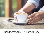 woman holding hot cup of coffee ... | Shutterstock . vector #485901127