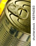 Aperture ring on a gold-colored tin - stock photo