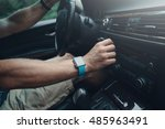 man driving a car and tuning... | Shutterstock . vector #485963491