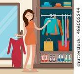 Woman Near Wardrobe For Cloths...