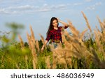 girl walking in field | Shutterstock . vector #486036949