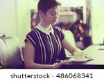 adult girl in a cafe | Shutterstock . vector #486068341
