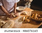 mid section of baker kneading a ... | Shutterstock . vector #486076165