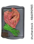Small photo of meat raw beef fillet chunk on black tray asparagus allspice isolated on white background empty space for text