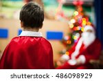 child and santa claus wearing a ... | Shutterstock . vector #486098929