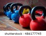 Small photo of Kettlebells (Girya) in a Gym.