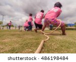 Blurry Image Of The Tug Of War...