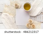 cup of tea with gloves  white... | Shutterstock . vector #486212317