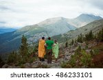 three people look at mountain... | Shutterstock . vector #486233101
