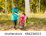 young mother and her toddler... | Shutterstock . vector #486236011