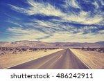 vintage toned desert road in... | Shutterstock . vector #486242911