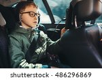 boy watch a tablet on the car... | Shutterstock . vector #486296869