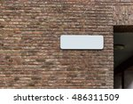 brick wall with a white tablet | Shutterstock . vector #486311509