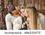 little girl with her parents in ... | Shutterstock . vector #486520375