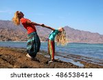 mother with daughter at beach | Shutterstock . vector #486538414