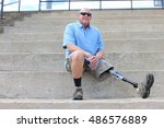 seated man with prosthetic leg... | Shutterstock . vector #486576889
