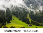 swiss huts  on the foggy... | Shutterstock . vector #486618931