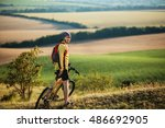 young man cycling on a rural... | Shutterstock . vector #486692905