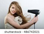 the girl plays with the hair... | Shutterstock . vector #486742021