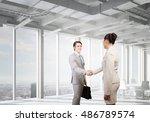 business partners handshake .... | Shutterstock . vector #486789574
