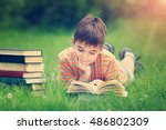 seven years old child reading a ... | Shutterstock . vector #486802309