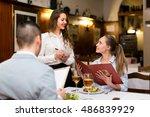 cheerful waitress serving rural ... | Shutterstock . vector #486839929