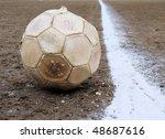 Soccer ball on a football field - stock photo